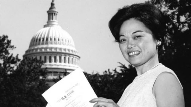 Woman in front of Capital Building